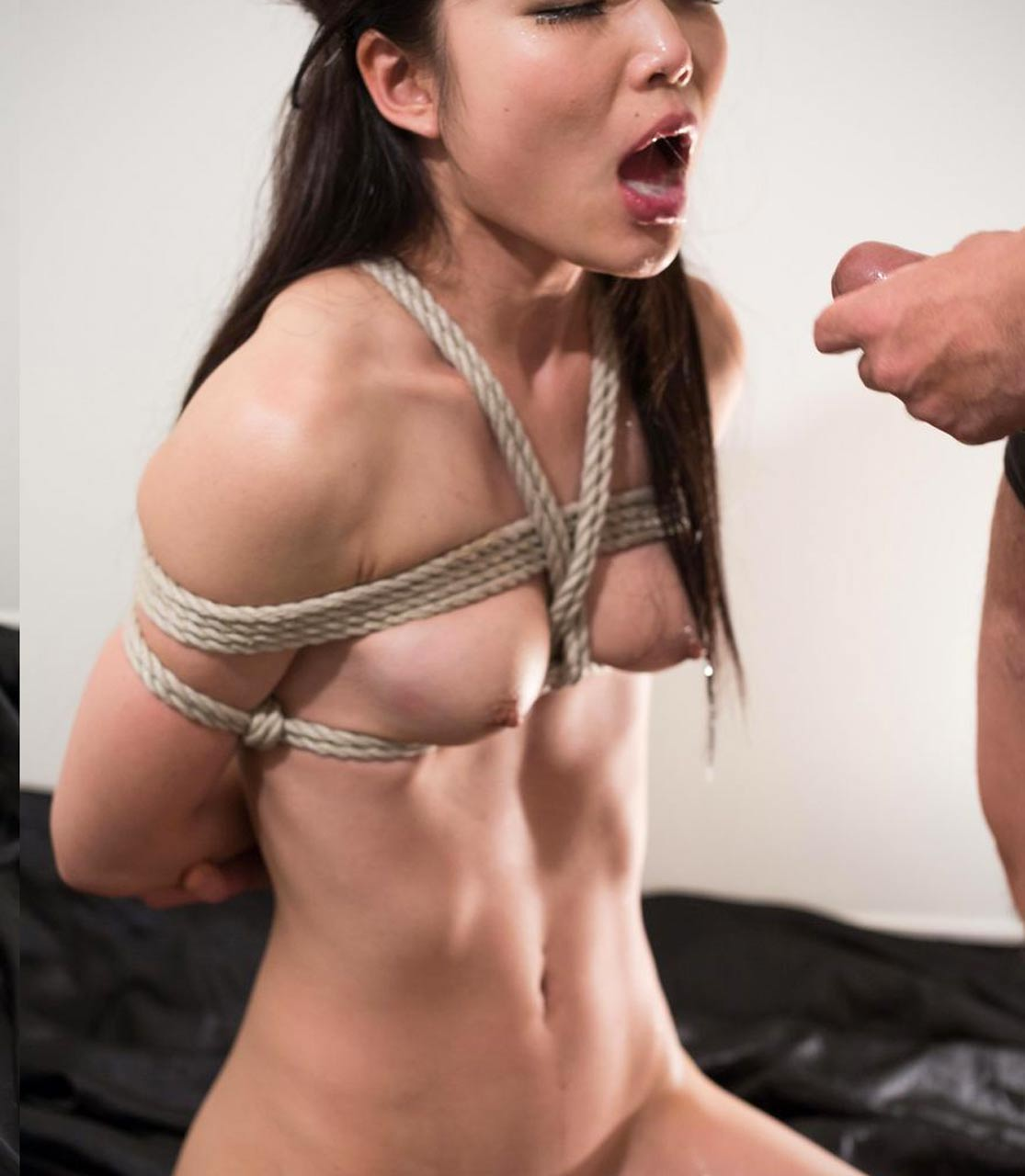 Shino Aoi, nude and bound as a sex slave at Tokyo Face Fuck. Uncensored BDSM facial sex.