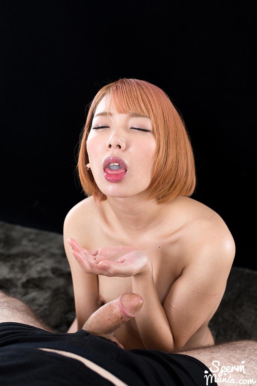Chie Kobayashi, all nude, sucks two cocks for a Cum Handjob.